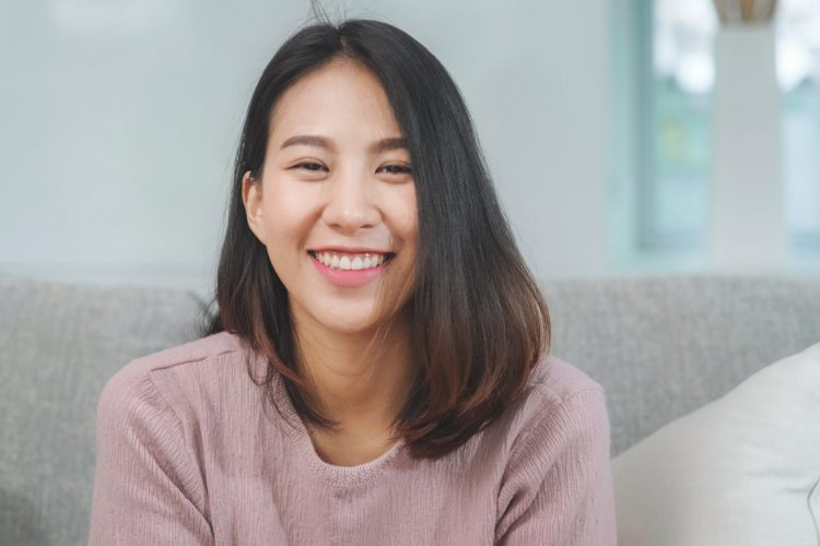 Picture of a lady smiling showing her teeth